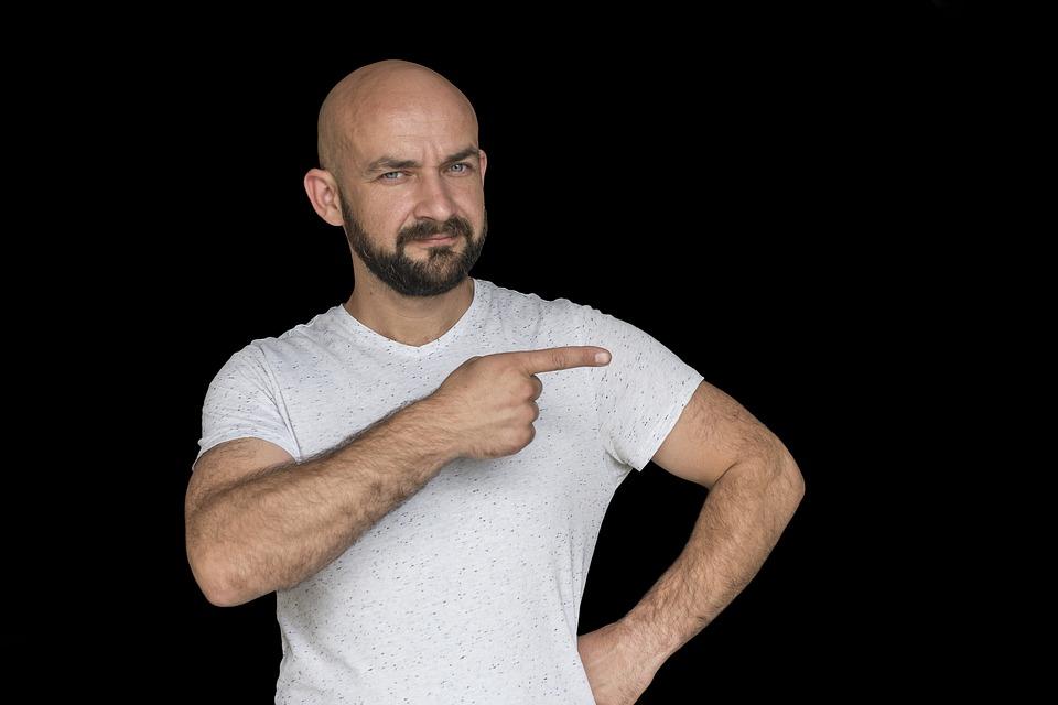 bald man pointing